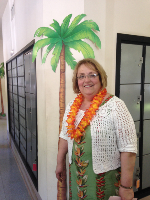 Cathy under a palm tree