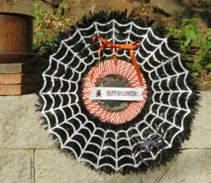 The spider appears on the wreath