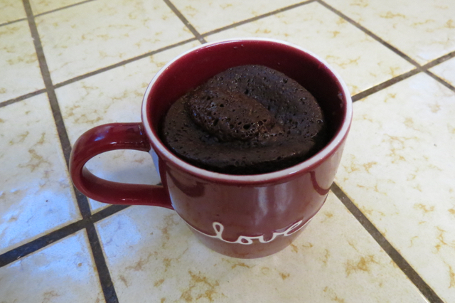 Cup of baked chocolate cake, right out of the microwave