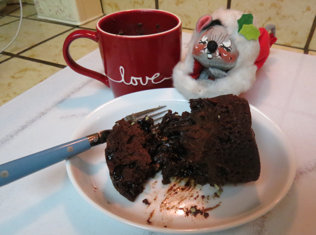 Little stocking mouse is ready for fresh chocolate cake