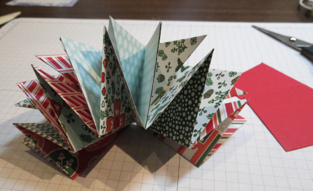 LAYER THE 5 FOLDED PIECES