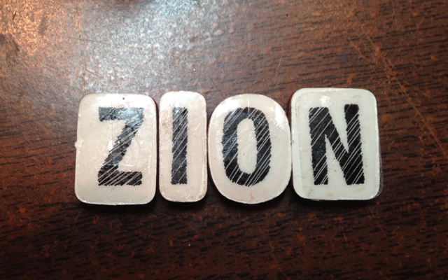 Place individual alphabet letters on table