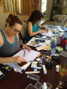 2- gals hard at work on their Hello Life Simply Created Kit components