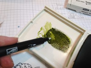 Get ink from the lid, gently holding blender pen at an angle