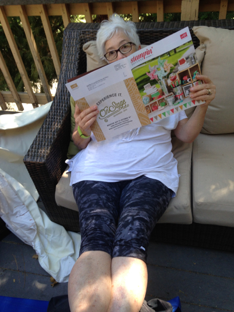 Blythe, on the front deck, getting comfy and reading July/August's Stampin' Success