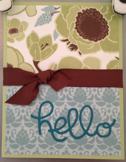 'Hello' die cut greeting added to the card front