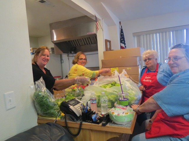 Donna, Cathy, Karen and Mary put together salad fixings