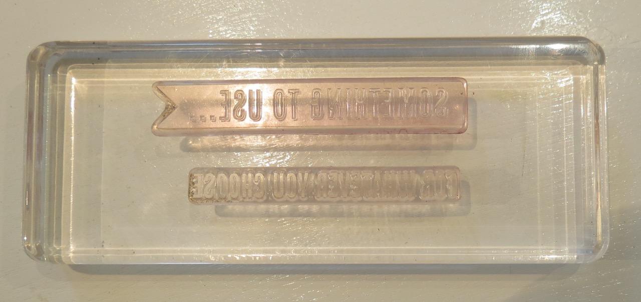 Photopolymer words on an acrylic block