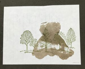Lay the cut out mask over the card stock stamped bear