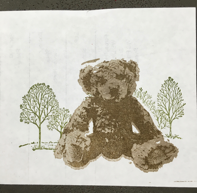 Remove the mask and the bear is sitting happily in front of the forest.