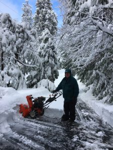 Hubby Russ clearing driveway